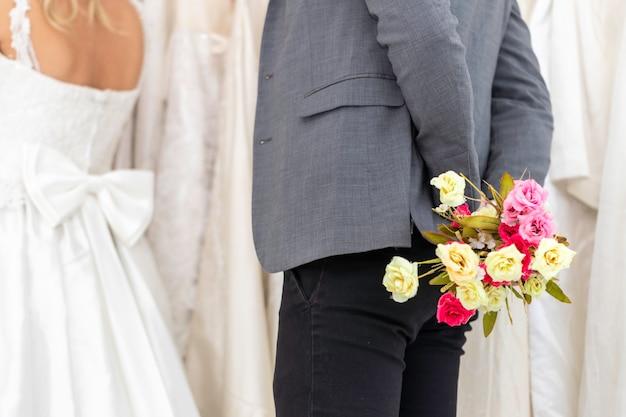 Groom caucasian give flower bride in wedding studio. Premium Photo