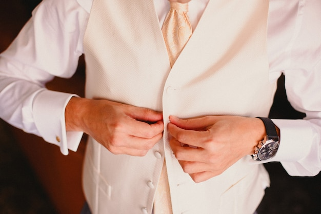 Groom getting ready to get married dressing Premium Photo