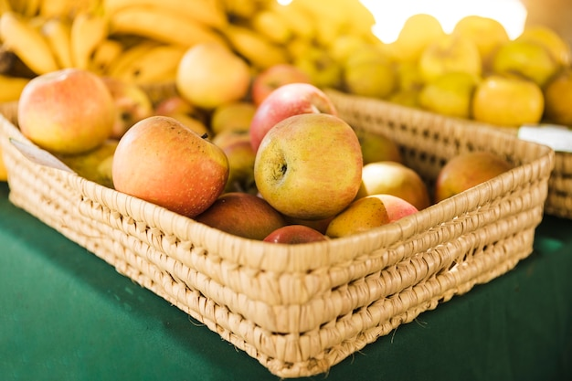 Group of apple in wicker basket on table at fruit market Free Photo