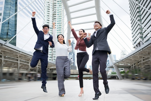 Group of asian business people success is jumping happily after sales continued. Premium Photo