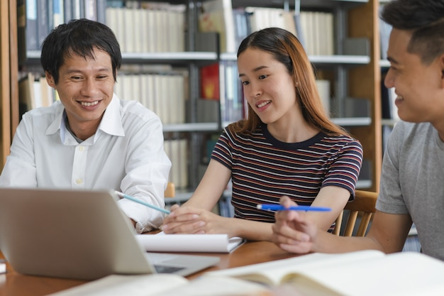 Group of asian students researching for project in library of university. Premium Photo