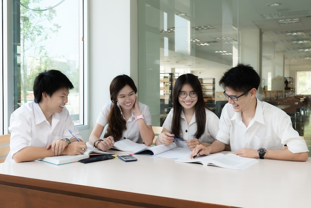 Group of asian students in uniform studying together at classroom. Premium Photo