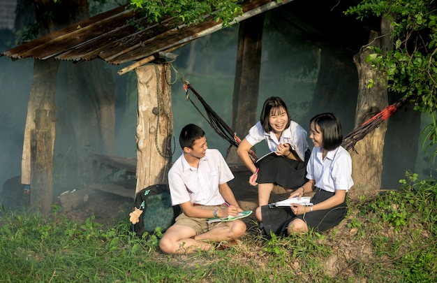 Group of asian students in uniform studying together at outdoor. Premium Photo