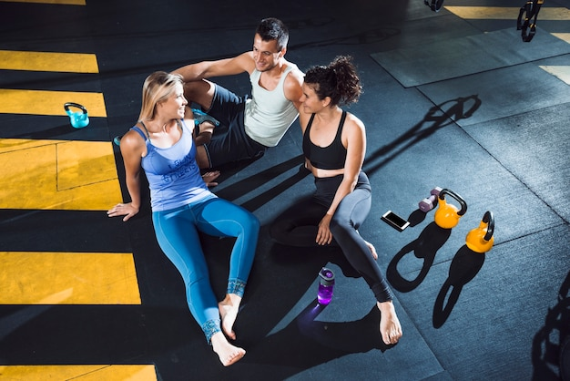 Group of an athletic people resting after workout Free Photo