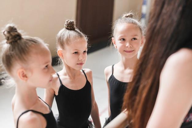 Group of ballerina girls with their teacher Free Photo