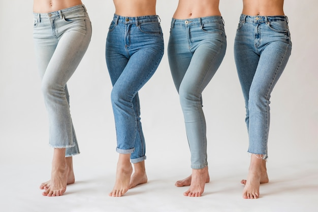 Group of barefoot women in jeans Free Photo