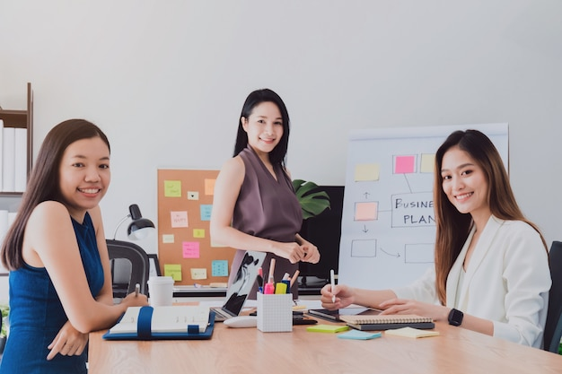 Group of beautiful  happy asian women meeting in office space to discussion business. Premium Photo