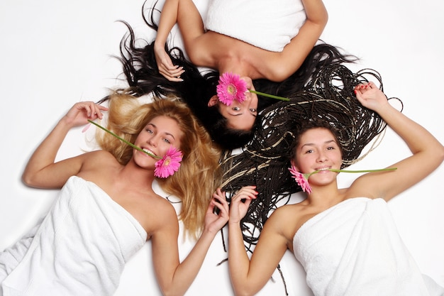 A group of beautiful womans fith flower Free Photo