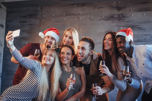 Group beautiful young people doing selfie in the new year party Premium Photo