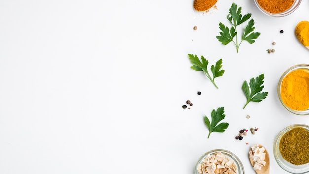 Group of bowls full of spices with leaves Free Photo