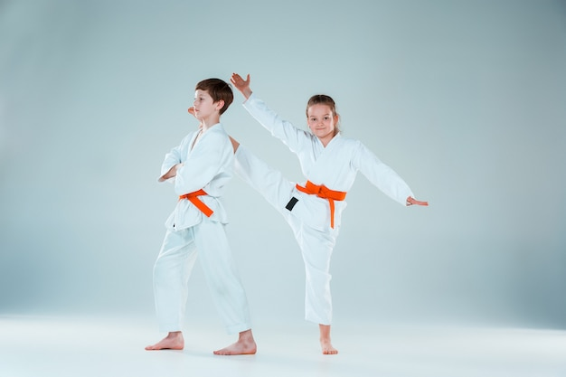 The group of boys and girl at aikido training in martial arts school. healthy lifestyle and sports concept Free Photo