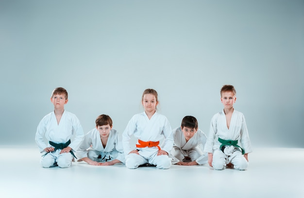 The group of boys and girl fighting at aikido training in martial arts school. healthy lifestyle and sports concept Free Photo