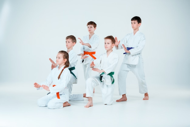 Group of boys and girl fighting at aikido training in martial arts school. healthy lifestyle and sports concept Free Photo