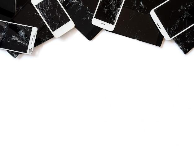 Group of broken smartphone screen (e-waste) isolate Premium Photo