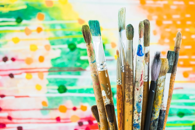 Group of brushes on colorful background Free Photo