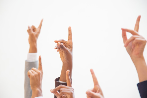 Group of business colleagues raising arms Free Photo
