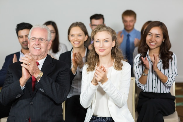Group of business people clapping Free Photo