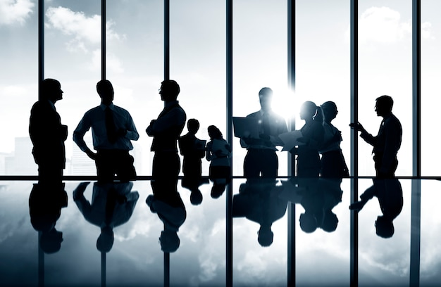 Group of business people discussing in a conference room. Premium Photo