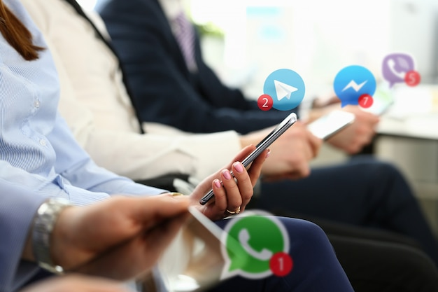 Group business people hold mobile device Premium Photo