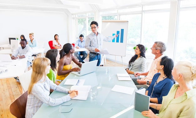 Group of business people planning and listening to the dicussion of their colleague Premium Photo