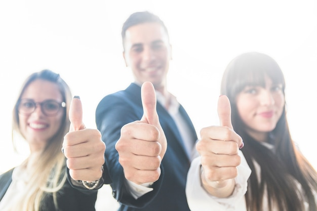 Group of business people showing thumb up sign Free Photo