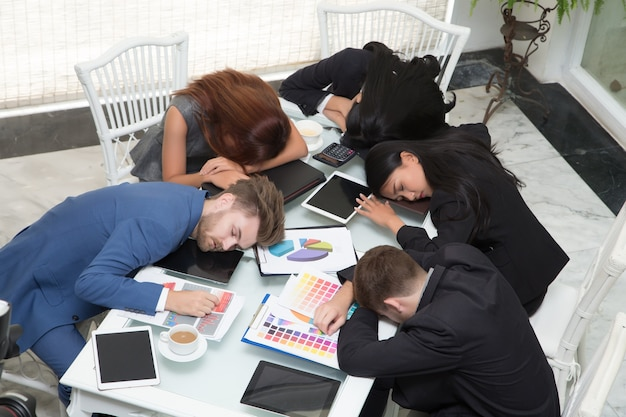 Premium Photo | Group of business people sleeping resting in the conference  room at office desk with close
