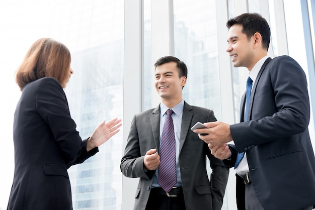 Group of business people talking at building hallway in the office Premium Photo