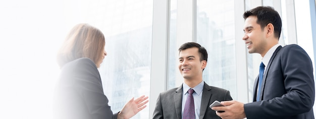 Group of business people talking at building hallway Premium Photo