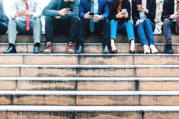 Group of business people use technology together of smartphone Premium Photo