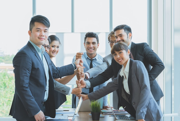 Group of business team fist hands stack together ready to work to success at the office. Premium Photo