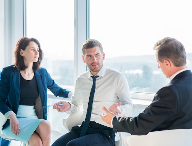 Group of businesspeople having conversation in office Free Photo
