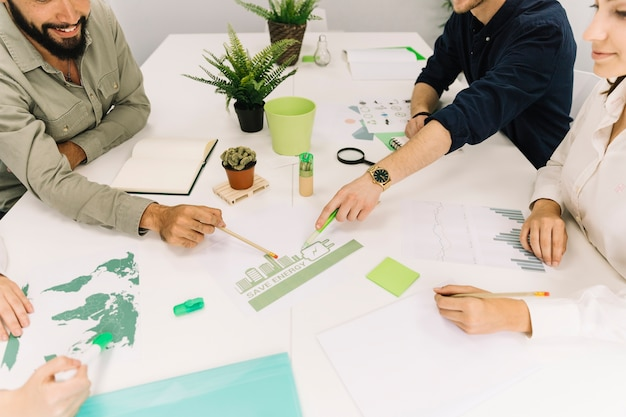 Group of businesspeople making plans on energy saving at workplace Free Photo
