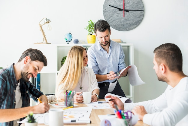 Group of businesspeople working together in office Free Photo
