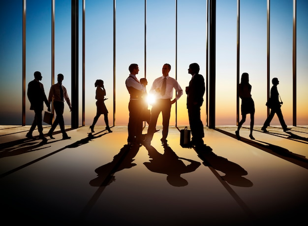 Group of busy business people in the building interior. Premium Photo