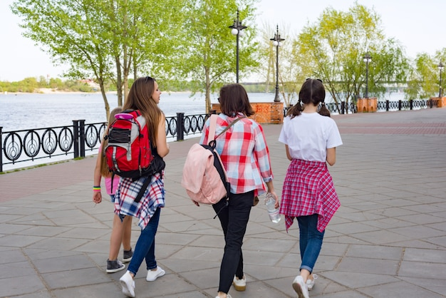 Group of children and women walking in the park. Premium Photo