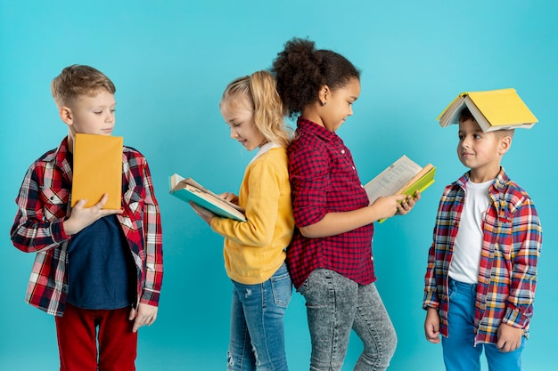 Group of childrens reading Free Photo