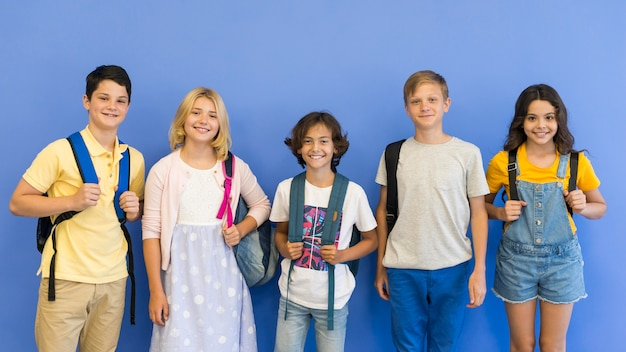 Group of childrens with backpack Free Photo