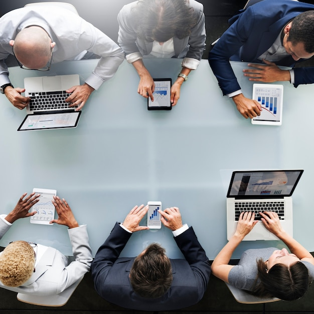 Group of diverse business people are using digital devices Premium Photo