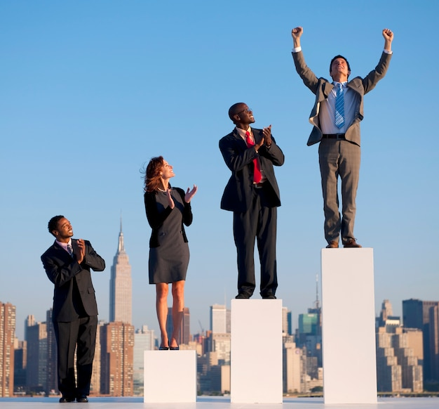 Group of diverse business people with growth graph Free Photo