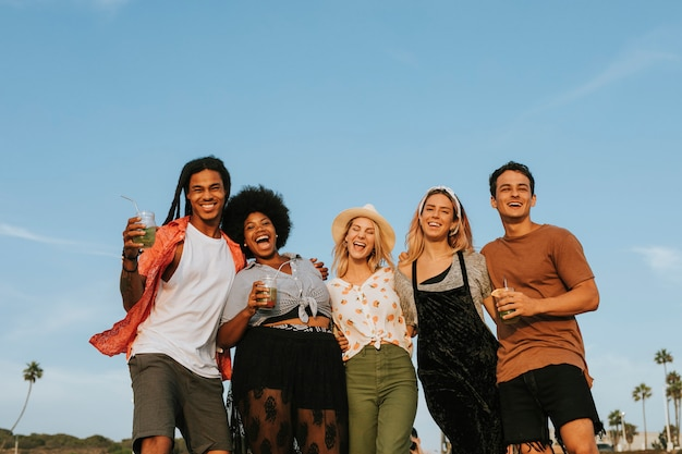 Group of diverse friends hanging out at the beach Premium Photo