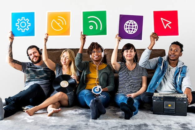Group of diverse friends holding technology icons Premium Photo