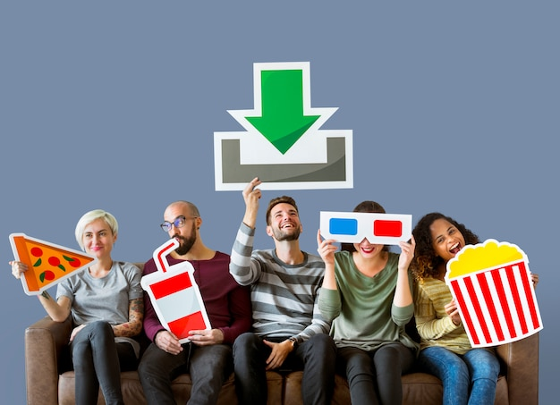 Group of diverse friends and movie download concept Free Photo
