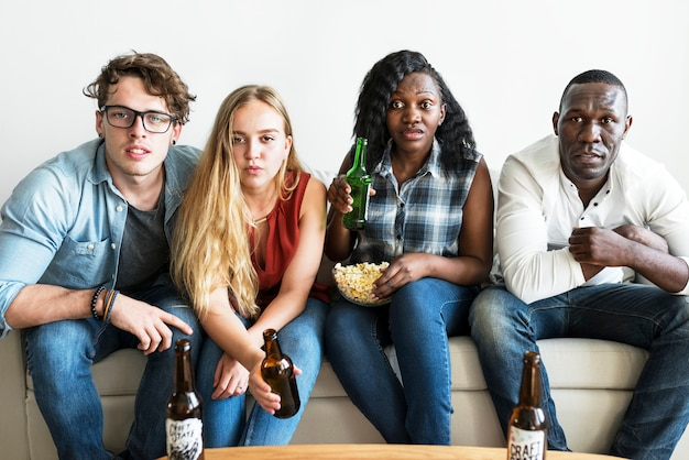 Group of diverse friends watching sports together seriously Premium Photo