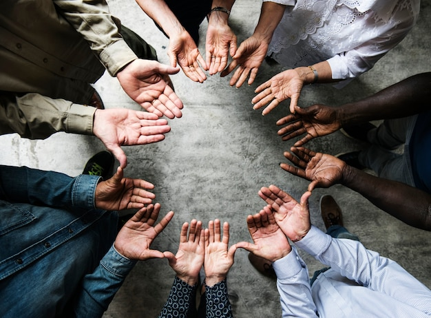 Group of diverse hands palms circle support together teamwork aerial view Premium Photo