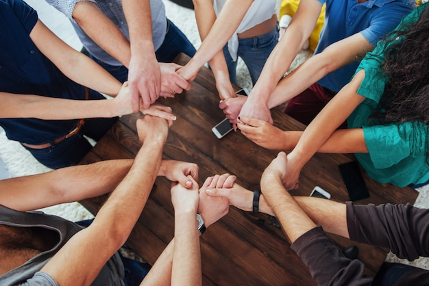Group of diverse hands together joining.   teamwork and friendship Premium Photo
