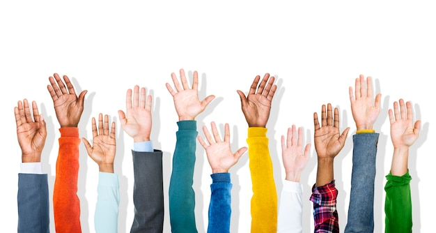 Group of diverse multiethnic colorful hands raised Premium Photo