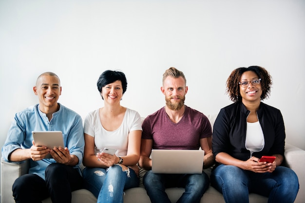 Group of diverse people using digital devices Premium Photo