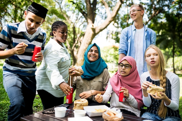 A group of diverse students are having lunch together Premium Photo