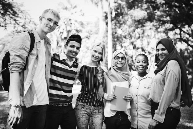 Group of diverse teenagers hanging out Free Photo