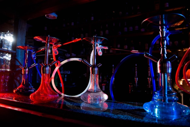Group of eastern hookahs on table of a bar. Premium Photo